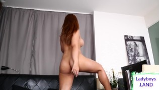 Big tittied redheaded ladyboy tugs cock