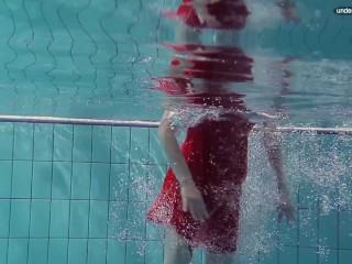 Hot naked girls underwater in the pool