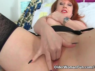 English horny mommy Red fills up her fanny with fingers