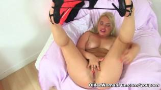 English milf Olga rubs her needy fanny