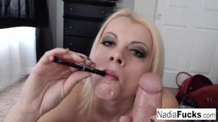 Sexy Nadia smokes an e-cig while also smoking a pole