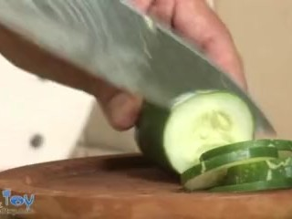Freaky boy plays with long and thick veggies and fruit