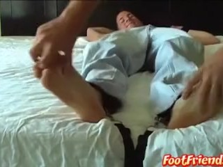 Young jock stripped and feet tickled in bondage torment