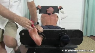 Bound muscular hunk in suit endures tickling tormenting