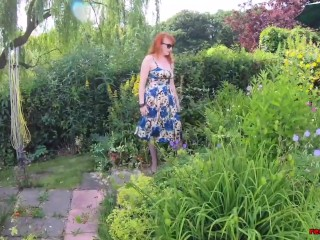Busty babe Red XXX fingers herself in the garden