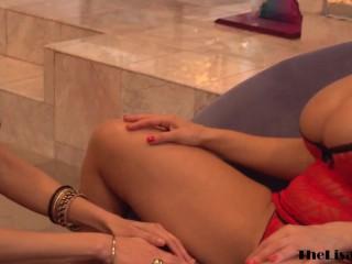 Busty MILF Lisa Ann toys lesbian teen by the fireplace