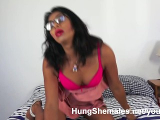Bright pink panties and bra cover a huge cock and small tits