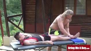 Inked twink barebacked after outdoor massage with daddy