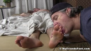 Very pretty dude has his toes licked while hes resting