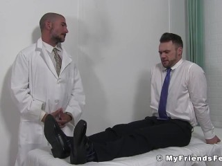 Young guy has his toes and feet licked by much older guy