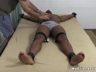 Muscular black guy has his feet tickled and dominated