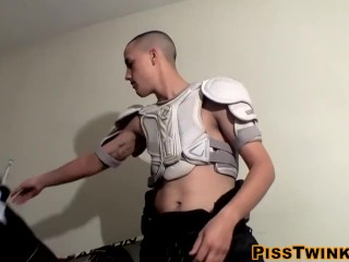 Young athlete tugs on his hard cock and pees on his fit body