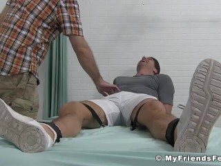 Attractive dude tied up to have his body and feet tickled