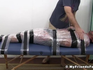 Naughty guy torments tied up friend and tickles his feet