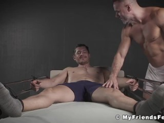 BDSM muscle hunk bare feet tickled by handsome horny guy
