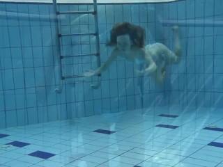 Small tits petite teen Clara underwater