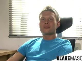 Tattooed twink Gary jerks off his big cock after interview
