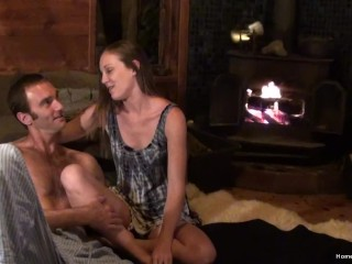 Real couple have intimate sex in front of the fireplace