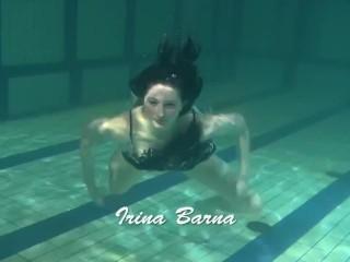 Dressed up teen Irina Barna swims sexy in the pool