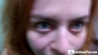 Amateur redhead takes a pecker on camera