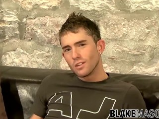 Slim twink Kane jerks off big throbbing dick after interview