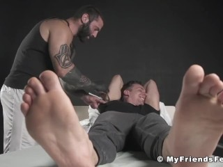 Cute barefoot jock tied up and tickled by horny inked hunk