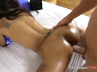 Oiled up her flawless Thai booty then banged her deep