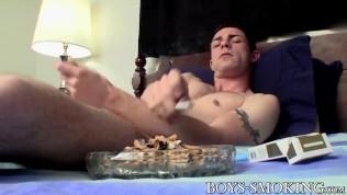 Perverted young homo smokes a cig and tugs his dick solo