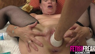 MILF gets a fist deep in her fat pussy