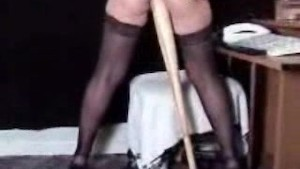 lady puts a baseball bat up her ass