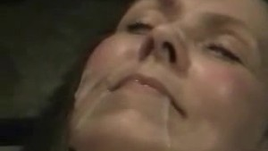 Mature woman getting a lot of cum in the face