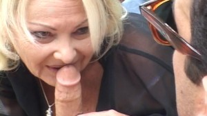Blonde oldie takes young man for a ride!