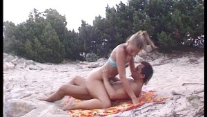 blonde beauty gives mouth to cock at the beach