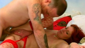Hot redhead dressed in red on fire [CLIP]