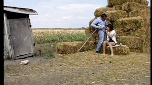 Farm maiden blows his haystack