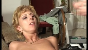 Salesman shows blonde new toys plus his own (clip)