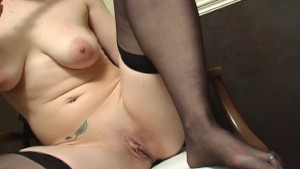 Horny girl wears her black stockings while playing with herself (CLIP)