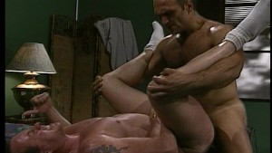 Two muscular hairy guys get sweaty with each other