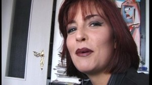 Redhead MILF shows her tits