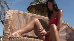 Suzie Diamond oiled in the sun