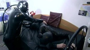 Spanking and whipping in latex suits