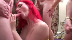 British redhead gets spunked on in bukkake party