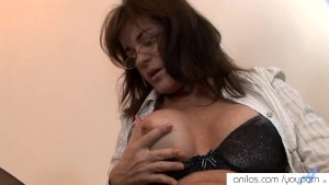 Cougar fingers her creamy cunt