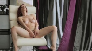 Redhead enjoy new dildo on the armchair