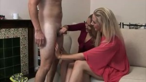 Clothed group of ladies strocking cock