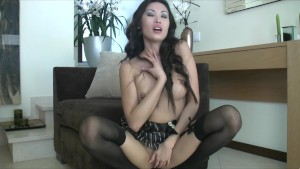 Sexy hot brunette Asian in lingerie finger-fucks pussy to orgasm