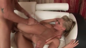 Shaved breasty pussy fucked on the sofa