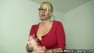 Milf gets turned on whille stroking his hard young cock