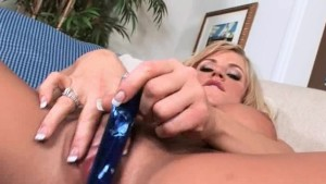 Busty bitch using huge glass dildo