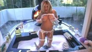 Blonde stripping in fishnet stockings and garter